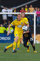 24 OCTOBER 2010:  Columbus Crew midfielder Kevin Burns (15) and Philadelphia Union midfielder Roger Torres (20) during MLS soccer game at Crew Stadium in Columbus, Ohio on August 28, 2010.