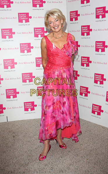 DIANA MORAN .Attending the Pink Ribbon Ball at the Dorchester Hotel, Park Lane, London, England, UK, October 10th 2009..full length pink floral print sleeveless dress shoes open toe .CAP/ROS.©Steve Ross/Capital Pictures.