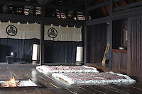 In the 'Zashiki' traditional futons and quilts are laid out for guests next to the warmth of the fire