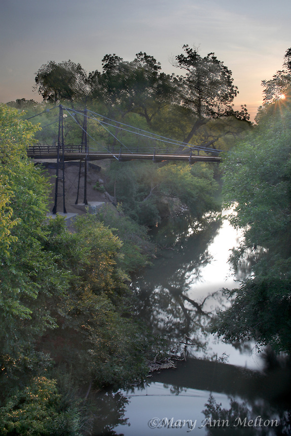 Capturing the feeling at sunrise at Beveridge bridge by combining two exposures to get the colors in the morning sky and yet have some detail in the bridge as well as  capturing first light on the foliage.