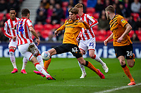 7th March 2020; Bet365 Stadium, Stoke, Staffordshire, England; English Championship Football, Stoke City versus Hull City; Martin Samuelsen of Hull City under pressure from Tommy Smith of Stoke City