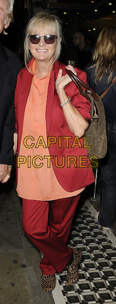 "TWIGGY LAWSON.""Top Girls"" theatre press night, Trafalgar Studios 1, Whitehall, London, England..August 16th, 2011.full length sunglasses shades suit red trousers jacket orange top.CAP/CAN.©Can Nguyen/Capital Pictures."
