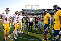 California captains' Mitchell Schwartz, Marvin Jones, D.J. Holt, Trevor Guyton and USC captains watch referee Jack Wood tosses a coin during the coin toss ceremony before the game at AT&T Park in San Francisco, California on October 13th, 2011.  USC defeated California, 30-9.