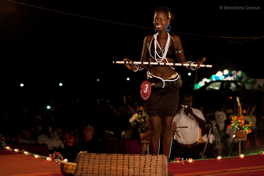 """4 december 2010 - Juba, Southern Sudan - Contestants participate in Miss Malaika South Sudan 2010 at Nyakuron Cultural Centre Juba. The contest featured 15 women from all 10 of South Sudan's states. The event was a way to show off their talents, traditions and culture. The competition was originally put together in 2005 by the southern Sudanese diaspora living in neighbouring Kenya. The word """"Malaika"""" means angel in Kiswahili, spoken widely in Kenya, the country where tens of thousands of southerners fled to, during ongoing conflicts. photo credit: Benedicte Desrus"""