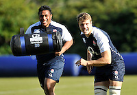 Bagshot, England. Mako Vunipola of England with Joe Launchbury of England during the England training session held at Pennyhill Park on November 8, 2012 in Bagshot, England.