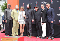 14 May 2019 - Hollywood, California - Lance Reddick, Laurence Fishburne, Halle Berry, Keanu Reeves, Ian McShane, Asia Kate Dillon, Mark Dacascos. Keanu Reeves Places His Hand Prints In Cement At TCL Chinese Theatre IMAX Forecourt. Photo Credit: PMA/AdMedia