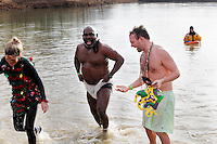 Teammates from Buckner Brewing Company take the plunge during the sixth annual Polar Plunge to raise money for Special Olympics Missouri on Saturday, Feb. 4, 2012, at Lake Boutin in Trail of Tears State Park.