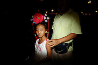 CHINA. Beijing. A young girl and her grandfather on Tiananmen Square during the Beijing 2008 Summer Olympics. 2008