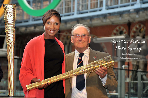 Denise Lewis and Austin Playfoot (Torchbearer at the London 1948 Olympics) with the torch. 2012 London Olympic Torch Prototype designed by Edward Barber and Jay Osgerby. St Pancras Station. London. 08/06/2011. MANDATORY Credit Sportinpictures/Garry Bowden - NO UNAUTHORISED USE - 07837 394578