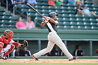 Outfielder Nick Williams (1) of the Hickory Crawdads bats in a game against the Greenville Drive on Friday, June 7, 2013, at Fluor Field at the West End in Greenville, South Carolina. Williams is the No. 25 prospect of the Texas Rangers, according to Baseball America and was a second-round pick in the 2012 First-Year Player Draft. The catcher is the Drive's Jayson Hernandez. Greenville won the resumption of this May 22 suspended game, 17-8. (Tom Priddy/Four Seam Images)