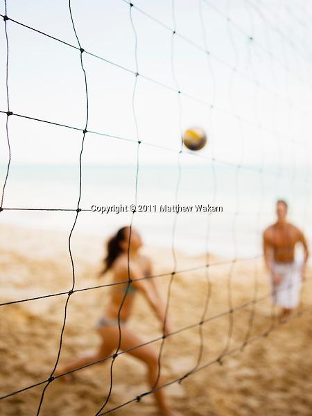 Couple Playing Beach Volleyball at Six Senses Hideaway Yao Noi, Koh Yao Noi, Thailand.