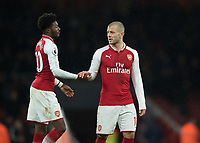 Jack Wilshere of Arsenal and Ainsley Maitland-Niles of Arsenal during the Premier League match between Arsenal and Newcastle United at the Emirates Stadium, London, England on 16 December 2017. Photo by Vince  Mignott / PRiME Media Images.