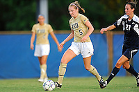 27 August 2011:  FIU's Johanna Volz (5) moves the ball upfield while being pursued by Akron's Maggie Rusnak (27) in the first half as the FIU Golden Panthers defeated the University of Arkon Zips, 1-0, at University Park Stadium in Miami, Florida.