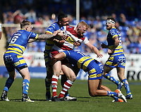 Wigan Warriors' Joe Bullock is tackled by Warrington Wolves' Sitaleki Akauola (right) and Ben Murdoch-Masila <br /> <br /> Photographer Stephen White/CameraSport<br /> <br /> Rugby League - Coral Challenge Cup Sixth Round - Warrington Wolves v Wigan Warriors - Sunday 12th May 2019 - Halliwell Jones Stadium - Warrington<br /> <br /> World Copyright © 2019 CameraSport. All rights reserved. 43 Linden Ave. Countesthorpe. Leicester. England. LE8 5PG - Tel: +44 (0) 116 277 4147 - admin@camerasport.com - www.camerasport.com
