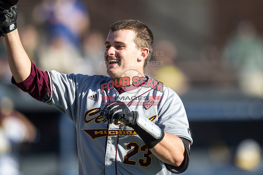 Central Michigan Chippewas catcher Robert Greenman (23) is greeted at the plate after hitting a home run against the Michigan Wolverines on March 29, 2016 at Ray Fisher Stadium in Ann Arbor, Michigan. Michigan defeated Central Michigan 9-7. (Andrew Woolley/Four Seam Images)