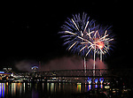 An Abstract Pattern Of Light Created By An Exploding Group Of Fireworks Over The Ohio River At Cincinnati Ohio, USA