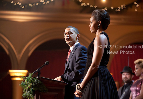 Washington, DC - December 13, 2009 -- United States President Barack Obama and First Lady Michelle Obama speak at the conclusion of the Christmas in Washington celebration in Washington, D.C., U.S., Sunday, December 13, 2009. .Credit: Joshua Roberts / Pool via CNP