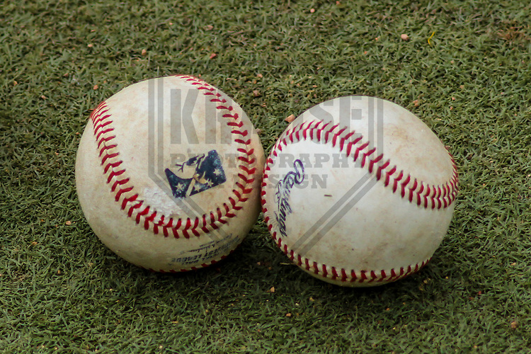 A pair of baseballs sit in the bullpen during a Midwest League game between the Cedar Rapids Kernels and the Wisconsin Timber Rattlers on August 6, 2017 at Fox Cities Stadium in Appleton, Wisconsin.  Cedar Rapids defeated Wisconsin 4-0. (Brad Krause/Krause Sports Photography)