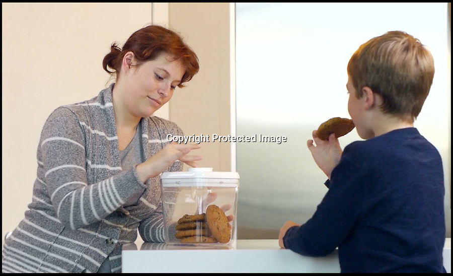BNPS.co.uk (01202 558833)<br /> Pic: BNPS<br /> <br /> ***Please use full byline***<br /> <br /> A chocolate-mad dad has invented a clever contraption to stop weak-willed dieters dipping into the biscuits and crisps.<br /> <br /> David Krippendorf would often ask his wife Jenny to hide junk food in the house so he could try and stick to a healthy diet and resist the temptation to eat it.<br /> <br /> But he was unable to ignore his sweet-tooth and always found himself hunting down the sugary snacks and binge eating.<br /> <br /> Eventually the father-of-one came up with an innovative idea that would keep his favourite treats locked away until after dinner.<br /> <br /> The Kitchen Safe is a plastic container with a lid that locks into place using small prongs for a certain length of time depending on the desired setting.<br /> <br /> To curb his cravings David places cookies, chocolates, sweets or crisps into the box and enters a timeframe from one minute to 10 days to lock them away for.<br /> <br /> The plastic receptacle will only open when the countdown has ended and the only other way to get into it is to physically smash it.<br /> <br /> The Kitchen Safe is currently being listed on Kickstarter, a website where members of the public can donate money to new products and ideas to get them manufactured.<br /> <br /> If it reaches the £19,400 target, David expects it to go on sale before September this year for £18.