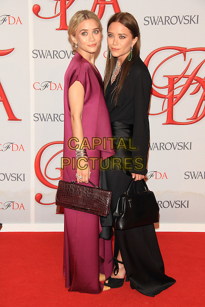 Ashley Olsen and Mary-Kate Olsen.The 2012 CFDA Fashion Awards held at Alice Tully Hall - Lincoln Center, New York, NY, USA..June 4th, 2012 .full length black  dress purple silk satin handbag top skirt twins sisters siblings family side .CAP/LNC/TOM.©LNC/Capital Pictures.