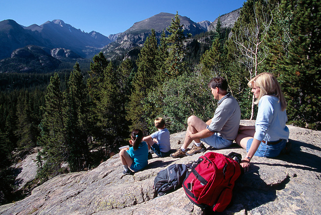 A family of four take a break after a hike in Rocky Mtn Nat'l Park, CO