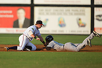Leonardo Molina (71) of the Pulaski Yankees is tagged out at second base by Danville Braves second baseman Matt Gonzalez (1) at American Legion Post 325 Field on August 1, 2016 in Danville, Virginia.  The Yankees defeated the Braves 4-1.  (Brian Westerholt/Four Seam Images)