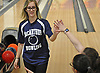 Hailey Hegdal of MacArthur gets friendly high fives from the opposing team after rolling a strike in a Nassau County girls bowling match against Levittown Division at Levittown Lanes on Wednesday, Jan. 3, 2018.