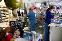 Staff nurses Julie Briere (left) and Avery Forget care for patients in the Neonatal Intensive Care Unit at Boston Children's Hospital in Boston, Mass., on Mon., June 13, 2016. Patient space, family space, and work space is all crowded together in the current NICU. The NICU will be greatly expanded under building plans for the hospital, but those plans will eliminate the Prouty Garden, a half-acre of green space at the hospital that many in the hospital community hold dear.