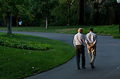 United States President Barack Obama and Vice President Joe Biden walk around the South Lawn of the White House, Sunday, July 24, 2011. .Mandatory Credit: Pete Souza - White House via CNP