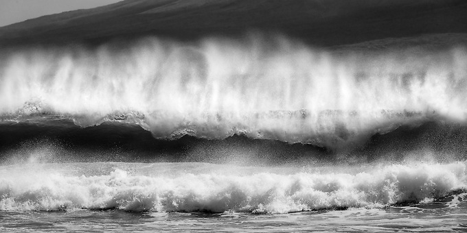 Huge waves crash ashore on the beaches of western Maui during a summer swell.