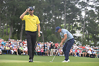 Webb Simpson (USA) and Brooks Koepka (USA) on the 18th green during the final round at the The Masters , Augusta National, Augusta, Georgia, USA. 14/04/2019.<br /> Picture Fran Caffrey / Golffile.ie<br /> <br /> All photo usage must carry mandatory copyright credit (© Golffile | Fran Caffrey)