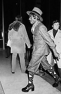Manhattan, New York City, NY - January 28, 1974<br /> Muhammad Ali and Joe Frazier at Madison Square Garden  - Billed as the &lsquo;Fight of the Century&rsquo; African-American boxing fans and dandies attended wearing the most glam-fashions of the day. Furs, minis and thigh-high platform boots were all the rage.