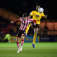 Lincoln City's Ellis Chapman vies for possession with Wolverhampton Wanderers U21's Niall Ennis<br /> <br /> Photographer Chris Vaughan/CameraSport<br /> <br /> The EFL Checkatrade Trophy Northern Group H - Lincoln City v Wolverhampton Wanderers U21 - Tuesday 6th November 2018 - Sincil Bank - Lincoln<br />  <br /> World Copyright © 2018 CameraSport. All rights reserved. 43 Linden Ave. Countesthorpe. Leicester. England. LE8 5PG - Tel: +44 (0) 116 277 4147 - admin@camerasport.com - www.camerasport.com