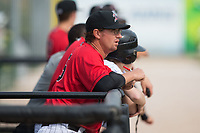 Kannapolis Intimidators pitching coach Matt Zaleski (25) watches the action from the dugout during the game against the Rome Braves at Kannapolis Intimidators Stadium on April 12, 2017 in Kannapolis, North Carolina.  The Braves defeated the Intimidators 4-3.  (Brian Westerholt/Four Seam Images)