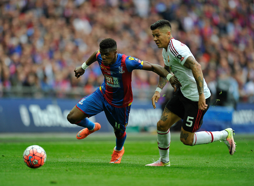 Crystal Palace's Wilfried Zaha holds off the challenge from Manchester United's Marcos Rojo<br /> <br /> Photographer Ashley Western/CameraSport<br /> <br /> Football - The Emirates FA Cup Final - Crystal Palace Manchester United - Saturday 21st May 2016 - Wembley - London<br /> <br /> &copy; CameraSport - 43 Linden Ave. Countesthorpe. Leicester. England. LE8 5PG - Tel: +44 (0) 116 277 4147 - admin@camerasport.com - www.camerasport.com