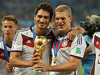 Mats Hummels and Matthias Ginter of Germany lift the World Cup trophy after winning the 2014 final
