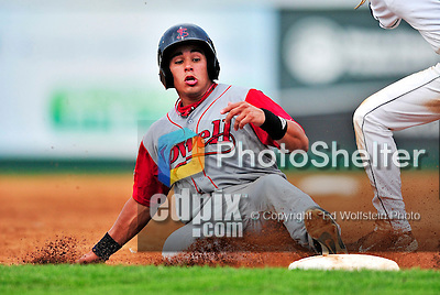 24 July 2010: Lowell Spinners catcher Jayson Hernandez slides safely into third during a game against the Vermont Lake Monsters at Centennial Field in Burlington, Vermont. The Spinners defeated the Lake Monsters 11-5 in NY Penn League action. Mandatory Credit: Ed Wolfstein Photo