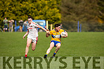 St Senans Darragh Behan slips past Cillian O'Riordan of St Pats Blennerville in the 3rd round of the Junior Premier Championship in Mountcoal on Sunday.