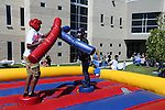 Jaime Avila and Milton Rodriguez joust during a student BBQ and club fair at Western Nevada College in Carson City, Nev., on Thursday, Sept. 1, 2016. <br />Photo by Cathleen Allison