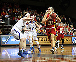SIOUX FALLS MARCH 22:  Paige Lungwitz #10 from Pittsburg State drives to the basket against Brionna Barnett #23 from Grand Valley State during their quarterfinal game at the NCAA Women's Division II Elite 8 Tournament at the Sanford Pentagon in Sioux Falls, S.D. (Photo by Dave Eggen/Inertia)