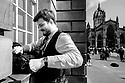 Edinburgh, UK. 15.04.2017. A piper prepares his instrument prior to busking on the Royal Mile. Photograph © Jane Hobson.