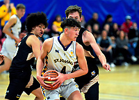 Action from the 2019 Schick AA Boys' Secondary Schools Basketball Premiership National Championship match between St Johns College Hamilton and Whangarei Boys' High School at the Central Energy Trust Arena in Palmerston North, New Zealand on Monday, 30 September 2019. Photo: Dave Lintott / lintottphoto.co.nz