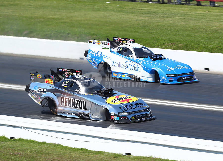 Apr 14, 2019; Baytown, TX, USA; NHRA funny car driver Matt Hagan (near) races alongside Tommy Johnson Jr during the Springnationals at Houston Raceway Park. Mandatory Credit: Mark J. Rebilas-USA TODAY Sports