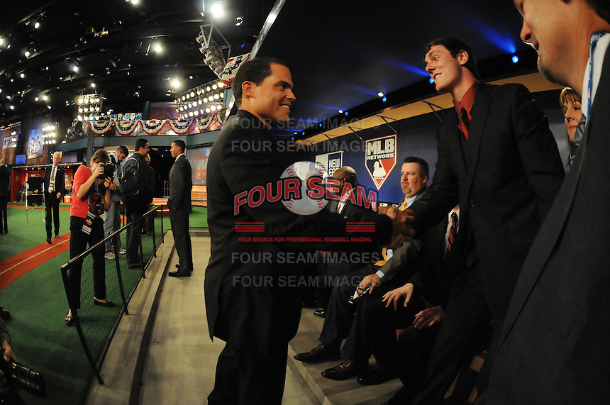 Catcher Clint Coulter (Union H.S.) the number twentyseventh overall pick to the Milwaukee Brewers and family meet All Star catcher Ivan Rodriguez during the MLB Draft on Monday June 04,2012 at Studio 42 in Secaucus, NJ.   (Tomasso DeRosa/ Four Seam Images)