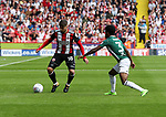 Kieron Freeman of Sheffield Utd in action with Rico Henry of Brentford during the English championship league match at Bramall Lane Stadium, Sheffield. Picture date 5th August 2017. Picture credit should read: Jamie Tyerman/Sportimage