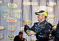 Feb 22, 2009; Fontana, CA, USA; NASCAR Sprint Cup Series driver Matt Kenseth celebrates with champagne after winning the Auto Club 500 at Auto Club Speedway. Mandatory Credit: Mark J. Rebilas-