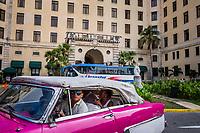 HAVANA, CUBA - SEPTEMBER 09: Tourists board a bus in front of the Hotel Nacional De Cuba on 9th of September, 2015 in Havana, Cuba. <br /> <br /> Daniel Berehulak for The New York Times