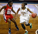 SIOUX FALLS MARCH 22:  Christina Davis #5 of Alaska Anchorage dribbles toward Francis Marion defender TeTe Flowers during their quarterfinal game at the NCAA Women's Division II Elite 8 Tournament at the Sanford Pentagon in Sioux Falls, S.D.  (Photo by Dick Carlson/Inertia)