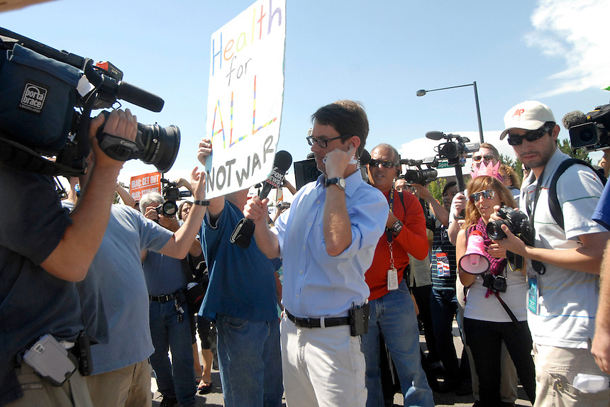 24 Aug 08: Fox News reporter Griff Jenkins is surrounded by protesters and individuals with cameras during a march from the state capitol to the Pepsi Center. Jenkins incited the crowd by challenging each comment he heard and running frantically through the crowd. On the day before the Democratic National Convention is scheduled to begin about 1,500 people participated in the ReCreate 68 rally, which included a march from the Colorado state capitol building to the Pepsi Center.
