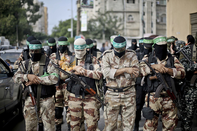 Palestinian Hamas militants attend the funeral of their comrade Amir al-Zaharnah who was killed in a Hamas training accident, in Gaza city November 15, 2015. Photo by Mohammed Talatene